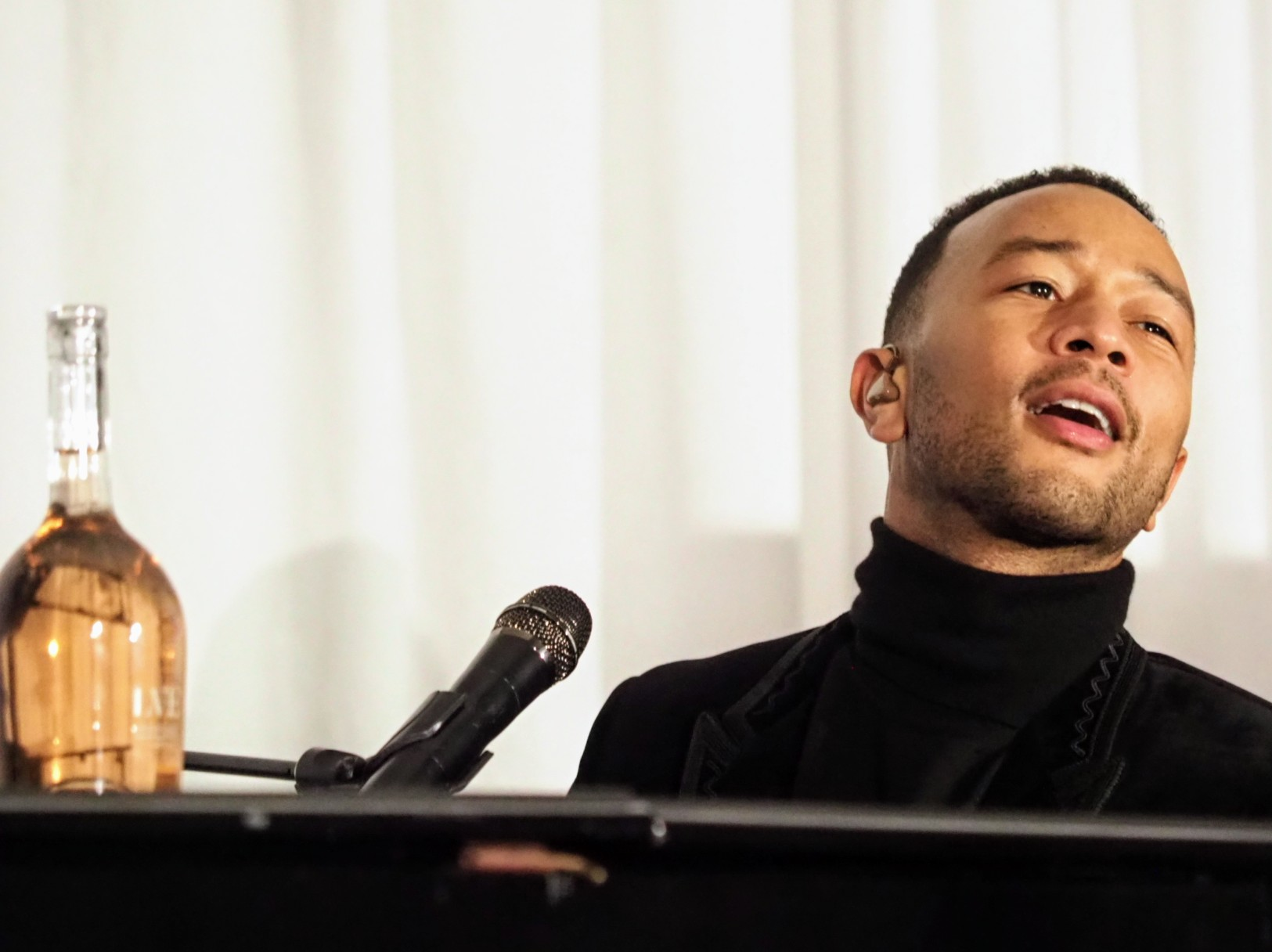 John Legend playing piano and singing