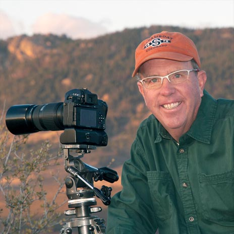 Tim O'Hara in nature with his camera on a tripod