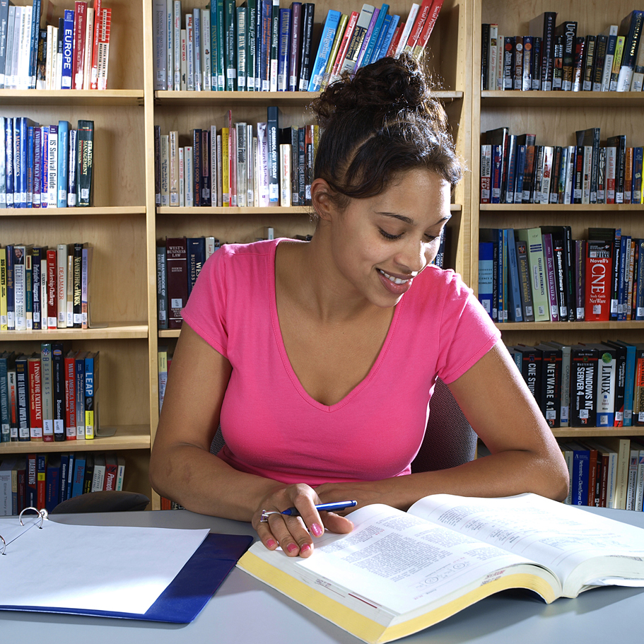 Woman studying in a library